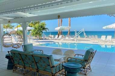 a pool club that fronts a white sand beach