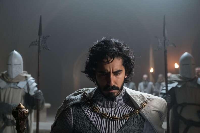the green knight, dev patel kneeling in king arthur's court