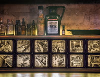 A shelf holding old-timey liquor