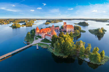 a large castle on an island in a lake