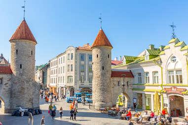 people walking through a medieval European old town