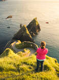 high angle view of a woman taking pictures at Dunquin Pier, along the Ring of Kerry on Dingle Peninsula