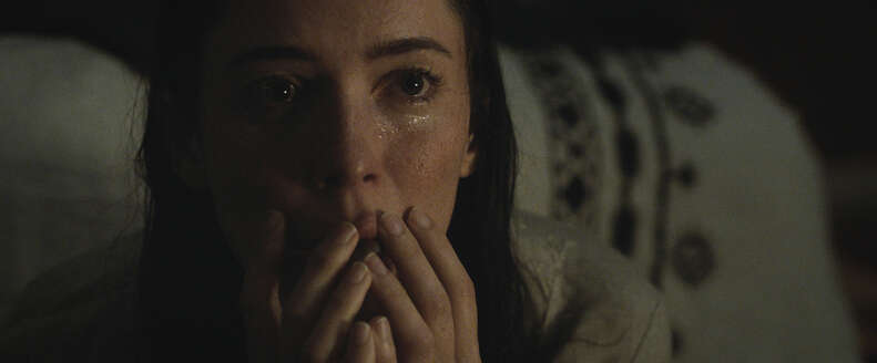 rebecca hall covering mouth in the night house