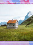 a mountain house in a field