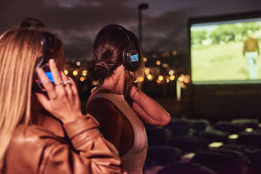 two women with headphones