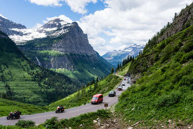 cars driving along a mountain highway pass