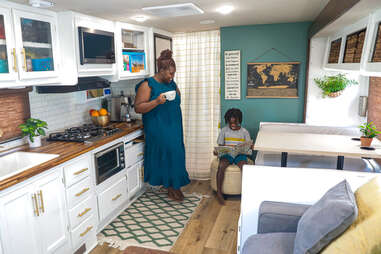 a mom and son in an upscale rv kitchen