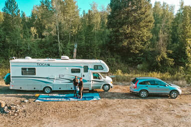 a family posing in front of their rv