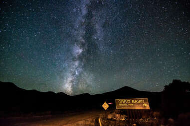 a road leading into the mountains on a starry night in Great Basin National Park, Nevada