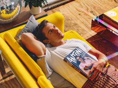 Antoni lounges on yellow sofa