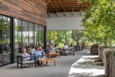 people lounging in an alfresco eating space