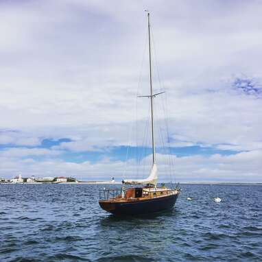 A classic sailboat in the Nantucket Harbor