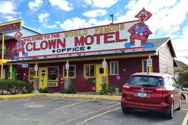an unusual clown motel beneath a blue sky