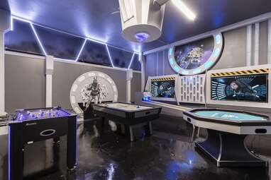 A Cinderella AND Star Wars-themed villa with a waterfall and grotto