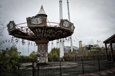 an abandoned carinval swing ride