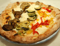 Pizza topped with mushrooms and zucchinis