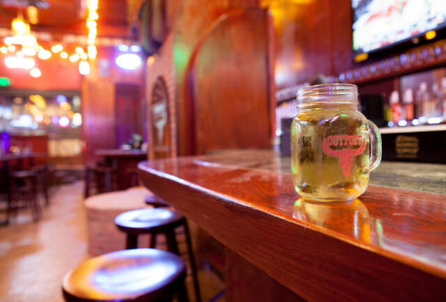 Cocktail-filled cowboy boots and Buck Naked wings on Cahuenga