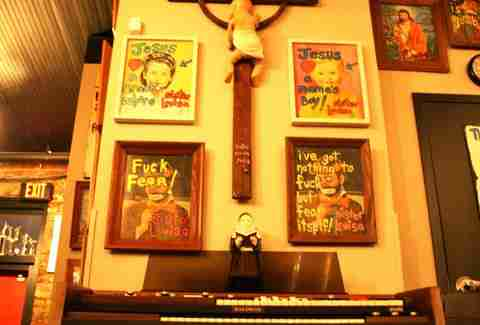 Various signs and a crucifix inside Sister Louisa's