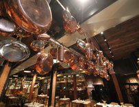 Copper pots and pans hanging from the ceiling