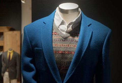 A mannequin wearing a blue suit jacket.