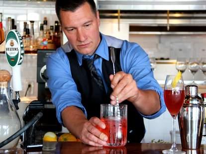 Bartender making cocktails at Monsoon East in Bellevue