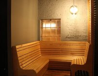 Wrap-around bench inside a small brick room