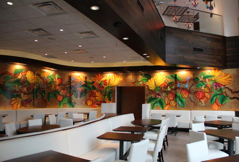 Seating area and wall mural inside Mi Cocina