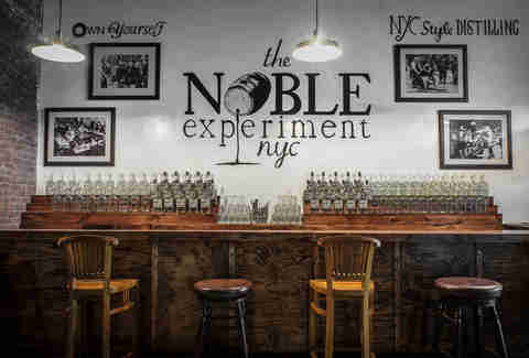 The Noble Experience logo printed on a wall