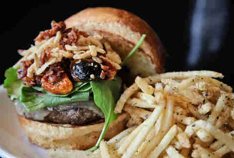Burger with crispy onions and fries