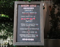 The Hudson Lodge's chalkboard sign