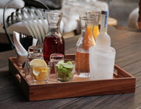 A tray holding booze and garnishes