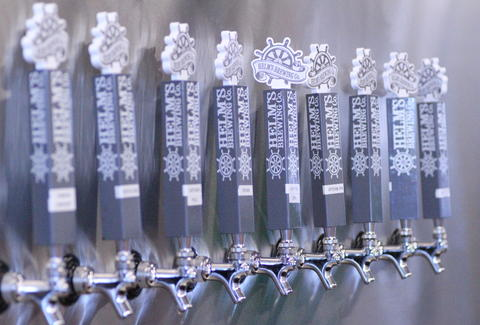 Beer taps at Helm's Brewing Co in San Diego