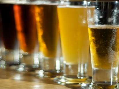 A selection of beers in tall glasses.