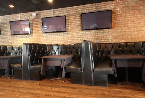 An interior shot for booths at The Greenville Tavern.