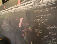 A chalkboard with bacon drawings