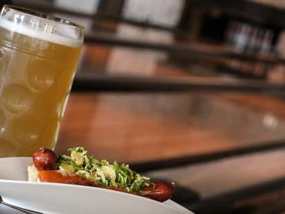A hot dog and a beer at Bowl and Barrel