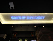 "Neon lights that say ""Baked by electricity"""