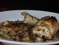 Close up of a roasted chicken dish.