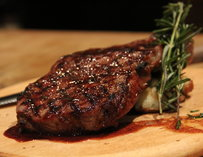 Steak garnished with rosemary