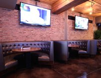 Indoor seating and flat screen TVs.