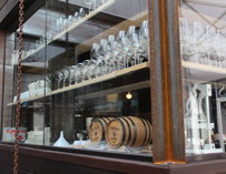 Wine glasses and barrels at Seven Lamps