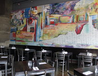 Wall mural and tables inside the One Sushi Plus