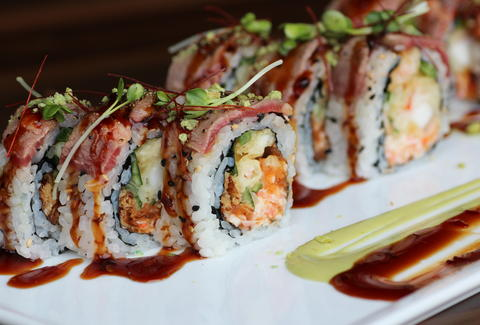 Elaborate sushi roll with sauce