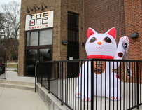 Large inflatable cat outside the One Sushi Plus