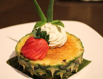 Creme brulee in a hollowed out pineapple
