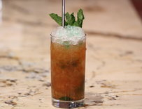 An icy cocktail garnished with mint