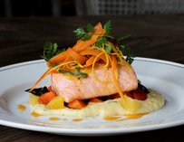 Citrus poached salmon w/ honey glazed carrots, tarragon polenta & blood orange buerre blanc
