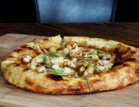 Poutine pizza topped with braised chicken & fried potatoes
