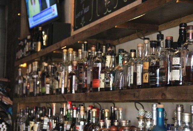 Drink whiskey flights, earn free whiskey bottles