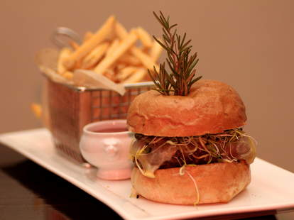 Burger and fries at Heat Bar & Kitchen in San Diego
